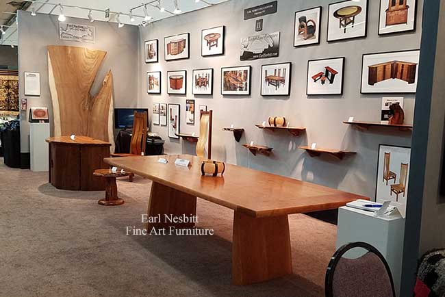 solid cherry conference table in booth at Objects Of Art Santa Fe Show
